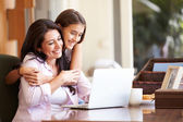 Mother And Daughter Looking At Laptop — 图库照片