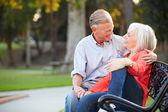 Mature Couple Sitting On Park Bench — Stock Photo