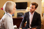 Woman Talking To Male Counsellor — Stock Photo