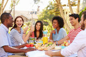 Friends Enjoying Meal At Outdoor Party — Stock Photo