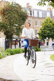 Woman Cycling in Urban Park — Stock Photo