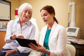 Cosmetic Surgeon Discussing Procedure With Client — Foto Stock