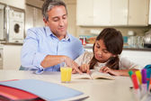Father Helping Daughter With Reading Homework — Stock Photo