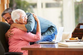 Senior Mother Being Comforted By Son — Stock Photo