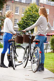 Two Women Cycling Through  Park — Foto de Stock