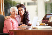 Daughter Helping Mother With Laptop — Stock Photo