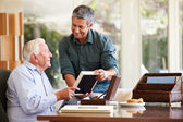 Senior Father Looking At Photo In Frame With Son — Stock Photo