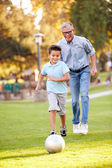 Grandfather Playing Football With Grandson — Stock Photo