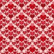 Seamless pattern with red hearts — ストックベクタ