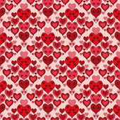 Seamless pattern with red hearts — Stock Vector
