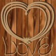 Heart of rope on a wooden background - Image vectorielle