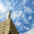 Chimney against the blue sky — Stock Photo