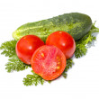Fresh cucumber and tomatoes on leaves of parsley — Foto de Stock