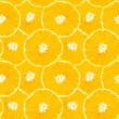 Seamless background from slices of orange — Stockvektor