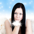 Royalty-Free Stock Photo: Angel blows some stars