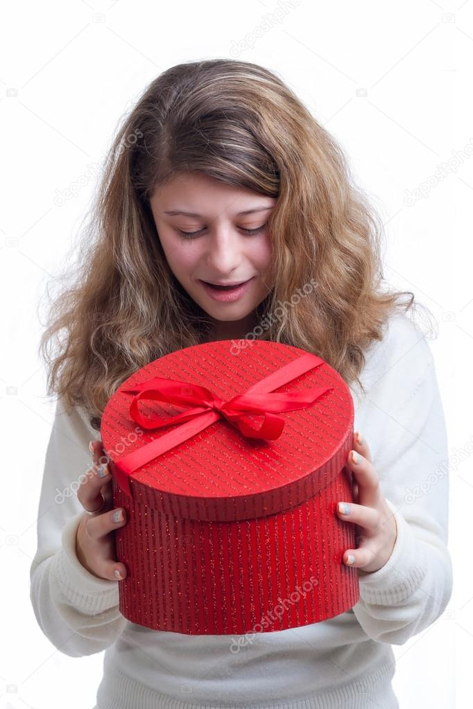 Beautiful smiling blond woman opens a red gift box isolated on white  — Stock Photo #16211013