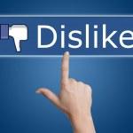 Pressing dislike button — Stock Photo