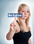 Woman pressing like and share button — Stock Photo