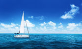 Yacht Sailing on water of ocean — Stock Photo