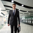 Stock Photo: Business man walking in subway