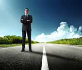 Business man stay on the road — Stock Photo