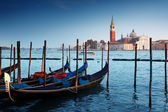 Gondolas on Grand Canal and San Giorgio Maggiore church in Venic — Foto de Stock