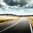 Tuscany road in sunny summer day — Stock Photo