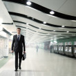 Business man walking in subway — Stock Photo