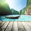 Rock of Phi Phi island in Thailand and wooden platform — Stock Photo