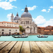 Stock Photo: BasilicSantMaridellSalute, Venice, Italy and wooden surf