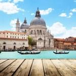 Basilica Santa Maria della Salute, Venice, Italy and wooden surf — Stock Photo #26516817