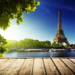 Stock Photo: Background with wooden deck table and Eiffel tower in Paris