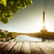 Background with wooden deck table and Eiffel tower in Paris — Stock Photo