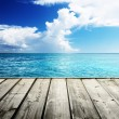Caribbean sea and wooden platform — Stock Photo #27098687