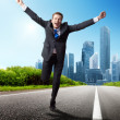 Business man run on the road — Stock Photo