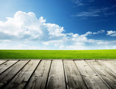 Green field and wood floor — Stock Photo