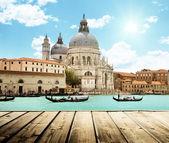 Basilica Santa Maria della Salute, Venice, Italy and wooden surf — Stock Photo