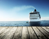 Caribbean sea and cruise ship and wood pier — Stock Photo