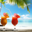 Stock Photo: Two fresh juices on beach