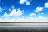 Asphalt road and perfect sky — Stock Photo
