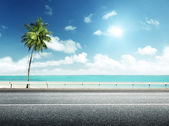 Asphalt road and sea — Stock Photo