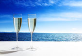 Champaign Glasses and open ocean — Stock Photo