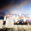 Glass of milk and night city — Stock Photo #39069293