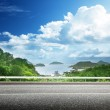 Asphalt road and tropical forest — Stock Photo