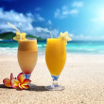 Fresh fruit juices on a tropical beach — Stock Photo #40914447