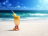 Fresh fruit mix of juices on a tropical beach — Stock Photo