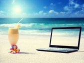Notebook on the beach and glass of fresh jucie — Stock Photo