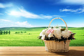 Flowers on table and spring field — Stock Photo