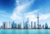 Shanghai skyline and sunny day — Stock Photo