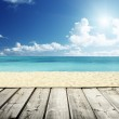 Tropical beach and wooden platform — Stock Photo #50145627